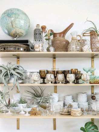 ??  ?? MAXIMIZE ON space and style with simple display shelves. Chi integrates a globe, a terra cotta pot and sundry goblets into one seamlessly elegant space.