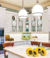 """?? KEVIN MEECHAN ?? Exposed Edison bulbs are """"just not great lighting,"""" says Margaret Handley of Dianne Davant & Associates. She suggests finding """"a different fixture that gives that same feeling,"""" such as the one here."""