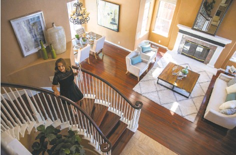 ?? Photos by Santiago Mejia / The Chronicle ?? Erika Carrasco, a real estate agent at San Jose's Intero Real Estate Services, visits a Silver Creek Valley Country Club home for sale.