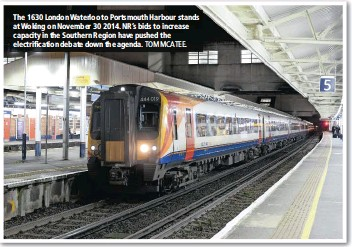 ?? TOM MCATEE. ?? The 1630 London Waterloo to Portsmouth Harbour stands at Woking on November 30 2014. NR's bids to increase capacity in the Southern Region have pushed the electrification debate down the agenda.