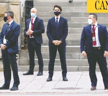 "?? BLAIR GABLE / REUTERS ?? Prime Minister Justin Trudeau waits to cross the street in Ottawa before a news conference on Tuesday. Trudeau's promises of ""modest, short-term deficits"" have flown straight out the window, writes John Ivison."