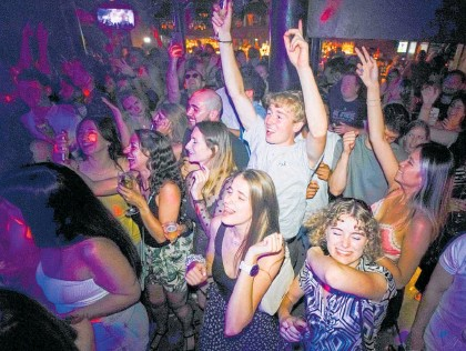?? Photo / AP ?? Revellers celebrate 'Freedom Day' in the UK, but sharemarkets aren't feeling the mood.