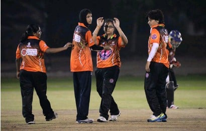 ?? Supplied photo ?? Humaira Tasneem (second left) celebrates with her UAE teammates during the GCC women's cricket tournament in Doha. —