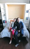 ??  JOHN LUCAS/POSTMEDIA NEWS ?? Asha Fritz and Colin Waugh have figured out how to live small in a loft condo. Their bookshelf quickly and easily folds out into a bed.