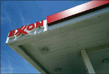 ?? THE ASSOCIATED PRESS ?? Exxon Mobil reported quarterly financial results on Friday. Exxon's oil and gas production fell 4.7 percent in the third quarter from the same period a year ago. Its production of the equivalent of 3.83 million barrels of oil per day in the quarter was...
