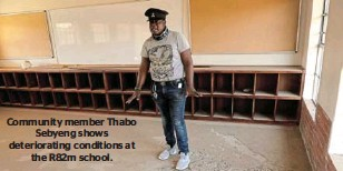 ??  ?? Community member Thabo Sebyeng shows deteriorating conditions at the R82m school.