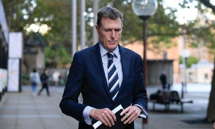 ?? Photograph: Dan Himbrechts/AAP ?? NSW police say investigation into allegations about Christian Porter, which he denies, remains closed despite statement from James Hooke.