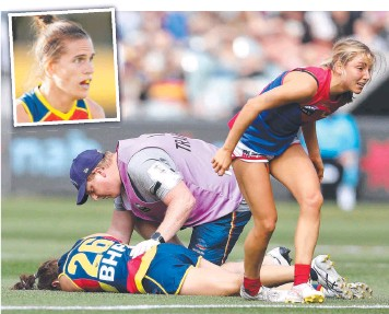 ??  ?? Demons player Eliza McNamara struggles to stand after her collision with Crows skipper Chelsea Randall (inset) in last weekend's preliminary final. Pictures: Getty Images