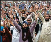 ?? PTI ?? Supporters of Tehreek-e-Labiak Pakistan, a radical Islamist political party, chant slogans during a sit-in protest against the arrest of their party leader Saad Rizvi and demanding to expel the French envoy from the country, in Lahore, Pakistan, Friday