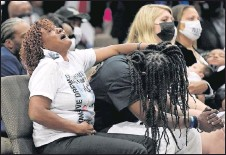 ?? THE ASSOCIATED PRESS ?? Family members grieved during Andrew Brown Jr.'s funeral in Elizabeth City, N.C., on Monday. Brown was fatally shot by sheriff's deputies.