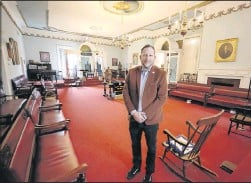 "??  ?? Randolph Lodge Master Jake Crocker stands inside Masons' Hall, the oldest building in the United States built and continuous­ly used for Masonic purposes. ""We'remeeting in a room thatwe've had the same meeting in — uninterrup­ted— since 1787,"" he said."