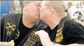 """?? Photo courtesy of the Boyett family ?? Danny """"Diesel"""" Boyett leans in for a kiss with his wife, Nina, at a Cossacks Motorcycle Club gathering. He was later shot and killed in Waco."""