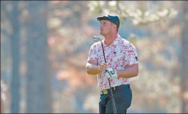 ?? CURTIS COMPTON/TNS ?? Bryson DeChambeau hits on the 17th fairway during the third round of the Masters.