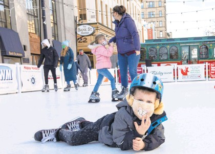 ?? MORNING CALLFILE PHOTO ?? Skaters use the ice rink on Dec. 27 in Easton's Centre Square. It's part of the city's Winter Village.
