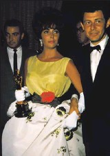 """??  ?? 1961: Taylor picked up her first Oscar (for Butter field 8) in this Christian Dior confection. """"She was always very in sync with the moment,"""" Duke says. """"The magic of that dress is doing a color at the waist, which makes her waist even smaller."""""""