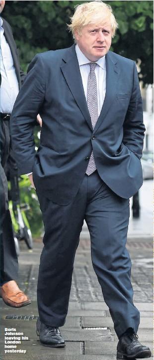 ??  ?? Boris Johnson leaving his London home yesterday