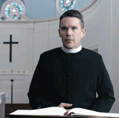 ?? A24 VIA THE ASSOCIATED PRESS ?? Ethan Hawke settles into the role of a melancholic priest as if he's never played anything else, Chris Knight writes.