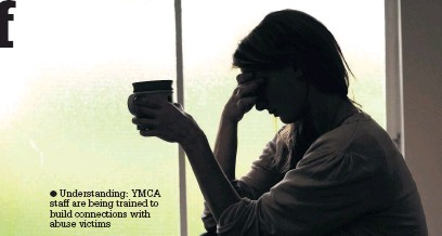 ??  ?? Understand­ing: YMCA staff are being trained to build connection­s with abuse victims