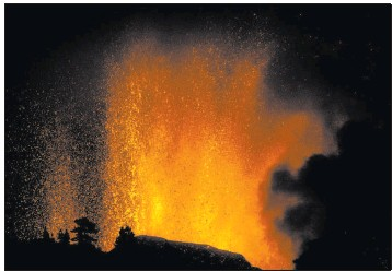 ?? Jonathan Rodriguez The Associated Press ?? Lava flows Sunday from an eruption of a volcano on the island of La Palma in the Canaries, Spain. The last eruption on the island occurred in 1971.