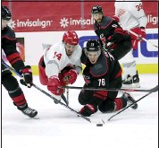 ??  ?? Carolina Hurricanes' Jordan Staal (11) and Brady Skjei (76) battle Detroit Red Wings' Robby Fabbri (14) for the puck during the first period of Thursday's game in Raleigh, N.C. The Red Wings fall to Hurricanes, 5-2. For full coverage of the game, go to our website at MacombDaily.com/sports.