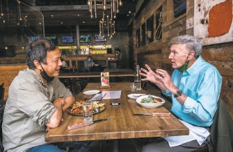 ?? Nick Otto / Special to The Chronicle ?? Dr. Michael Lu (left), dean of the UC Berkeley School of Public Health, dines out in Berkeley with former dean Stephen Shortell for the first time in more than a year.