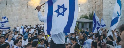 ?? (Olivier Fitoussi/Flash90) ?? PARTICIPANTS DANCE outside Damascus Gate during the flag march in Jerusalem on Tuesday.
