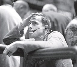 ?? Reuters photo: John Gress ?? BAD DAY: A trader reacts Monday at the Chicago Mercantile Exchange.