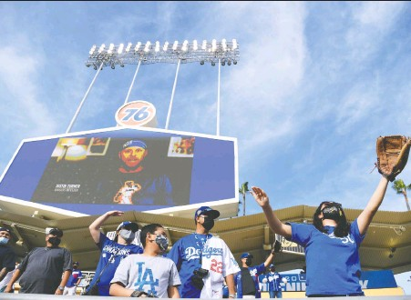?? HARRY HOW/GETTY IMAGES FILES ?? Known as creatures of habit, ballpark season-ticket holders are facing more unpredictability and pressures. Teams need to adhere to COVID rules like social distancing and capacity restrictions. The Dodgers can only sell about 15,000 seats per game out of 56,000.