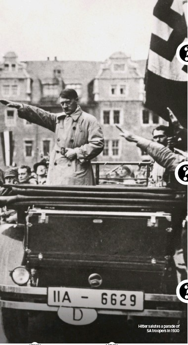 ??  ?? Hitler salutes a parade of SA troopers in 1930