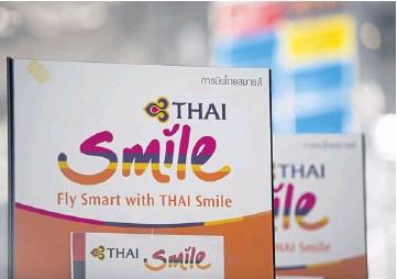 ??  ?? Signage for THAI's Thai Smile regional unit stands at Suvarnabhumi airport.