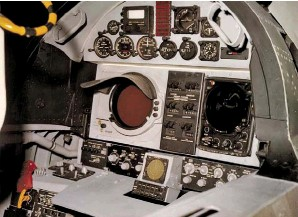 ??  ?? RAN's cockpit: the CRT for television and radar on the left, readouts for ASB-12 Inertial Navigation system in the center, and the optical viewfinder on the right. The small scope is the missile/AAA warning system. (Photo courtesy of the USN)