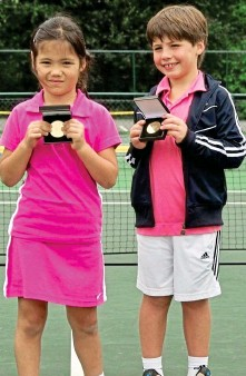 ??  ?? Childhood pals: With their matching medals ...
