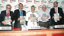 ??  ?? Dr CP Joshi (at the centre) along with other dignitaries releasing the Knowledge Paper at the 'India Infrastructure Summit 2012'