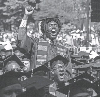 ?? STEVE SCHAEFER/AP ?? Graduates react after hearing billionaire technology investor and philanthropist Robert F. Smith say he will provide grants to wipe out the student debt of the entire 2019 graduating class at Morehouse College in Atlanta.