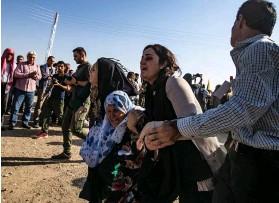 ??  ?? Otages. Al-Malikiyah, le 13 octobre. Des milliers de civils sont à nouveau contraints à l'exode.