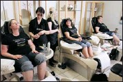 ?? Photos, Gavin Young, Calgary Herald ?? Herald Health Club finalists, from left, Sharleen, Tracey and Karen enjoy pedicures during their makeover.
