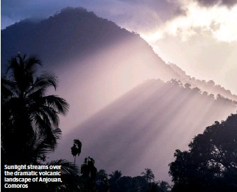 ??  ?? Sunlight streams over the dramatic volcanic landscape of Anjouan, Comoros