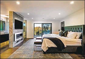 ??  ?? THE REIMAGINED three-bedroom contemporary home features backlit accent walls and a master suite with two closets.