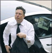 ?? MATT ROURKE ?? Elon Musk arrives at the justice center in Wilmington, Del., Tuesday, July 13, 2021. Musk took to a witness stand Monday to defend his company's 2016 acquisition of a troubled company called SolarCity against a shareholder lawsuit that claims he's to blame for a deal that was rife with conflicts of interest and never delivered the profits he had promised. (AP Photo/ Matt Rourke)