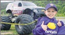 ?? JOE GIBBONS/THE TELEGRAM ?? Seven-year-old Nevaeh Denine of Goulds shows her opinion of the monster truck Scarlet Bandit outside the Janeway in St. John's Friday. Nevaeh will be the honourary race starter Saturday Eastbound Park in Avondale Saturday as the Scarlet Bandit, Bounty...