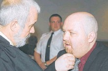 ?? TELEGRAM FILE PHOTO ?? Brian Doyle (right) speaks to lawyer John Duggan in Newfoundland and Labrador Supreme Court in St. John's in 2002.