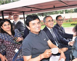 ??  ?? Infosys CEO Salil S Parekh ( second from right) flanked by CFO M D Ranganath ( on Parekh's right), and CTO Pravin Rao at the firm's Bengaluru headquarters on Friday