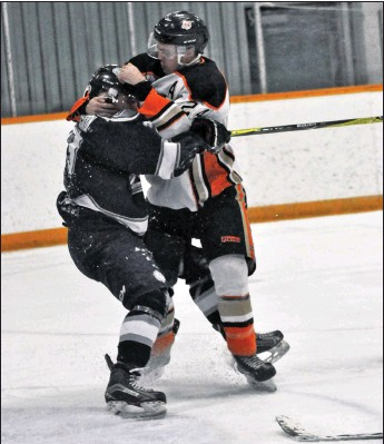 ?? File photo ?? The Coaldale Copperheads are back at it as they are holding training cam in anticipation of Heritage Junior B Hockey League season. Part of it will be renewing hostilities with rival Medicine Hat Cubs. Here back in 2019 playoffs, Coaldale defenceman Mitchell Konschuk comes to the aid of goalie Nolan Berner who got heavily bodychecked and had his mask sent flying by Cubs' Tavin Stadnicki (above).