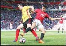 ??  ?? Watford's Craig Cathcart (left), and Manchester United's Alexis Sanchez battle for the ball during their English Premier League soccer match at Old Trafford, Manchester, England on May 13. (AP)