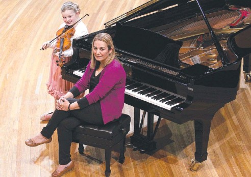 ?? Photo: Sarah Marshall ?? STRIKING A CHORD: Benazir Anwar and Clare Pausina, 8, are hoping their submissions make the cut for the Symphony For Me concert at QPAC as part of the Brisbane Festival.