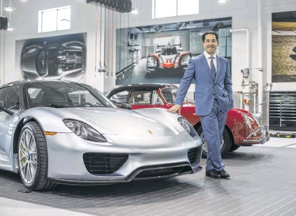 """?? Michael Starghill Jr. photos ?? Todd Blue shows a Porsche 918 Spyder and a Porsche 1600. He credits Houston for his success: """"There's something in the water that is celebratory of the entrepreneur and of business people that take a risk. Other cities are not like that."""""""