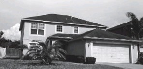 ??  ?? This large two-story home with a hip roof is typical of many being built along the S.R. 54 corridor. They offer plenty of room for growing families, who are among the primary buyers in the regions. This home is in the Suncoast Pointe community near the Suncoast Parkway.