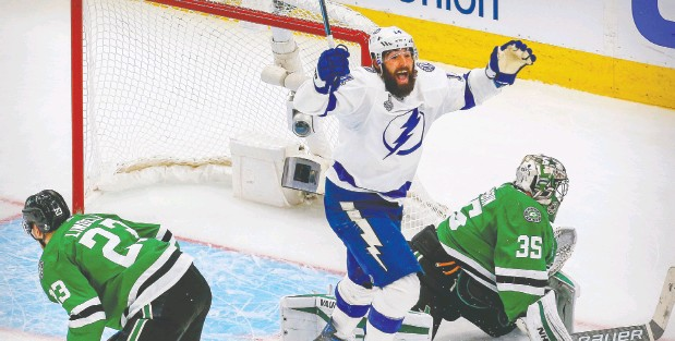 ?? Pery Nelson / USA TODAY Sports ?? Tampa Bay Lightning forward Patrick Maroon celebrates a goal by centre Blake Coleman against the Dallas Stars during Monday's game.