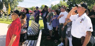 ?? ARI BURACK/THE NEW MEXICAN ?? Veterans salute during the singing of the national anthem at Saturday's Purple Heart Recognition Ceremony in Santa Fe.