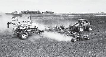 ?? DAN ERDMANN/FARM RESCUE ?? Volunteers plant crops in June on Paul Ivesdal's farm while he was sickened by COVID-19.